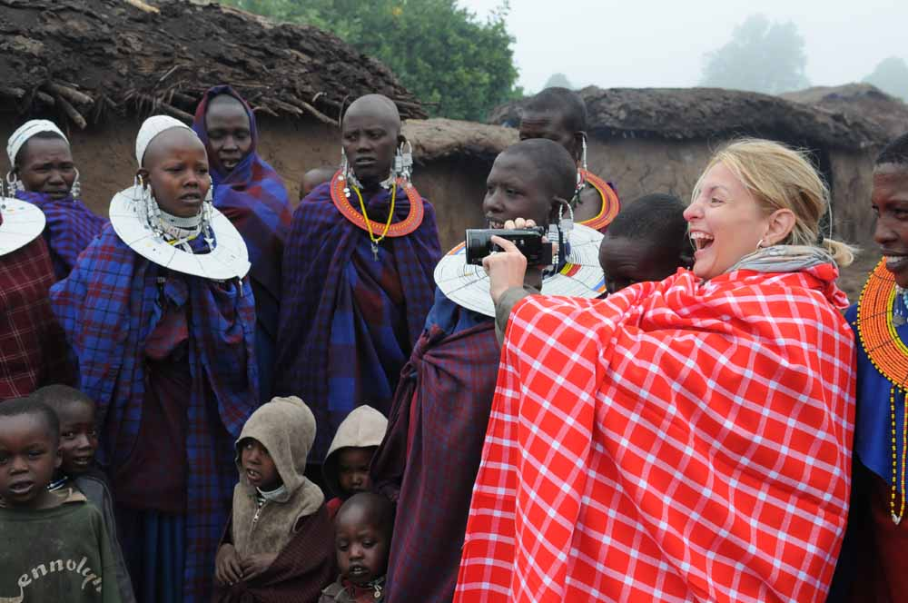 Suzette Munson videoing Masai singing in Africa